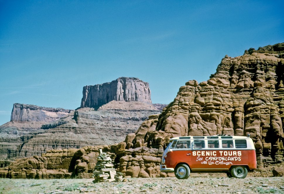 Free image of Volkswagen tour bus and stone rune in Canyonlands National Park, Utah, USA
