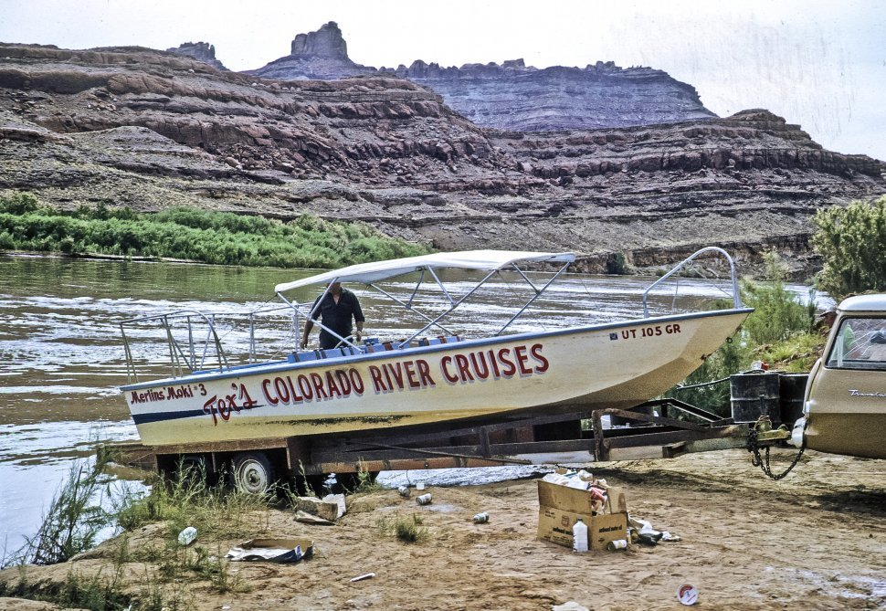 Free image of Guide in a river boat cruise vessel with supplies, Colorado River, Arizona, USA