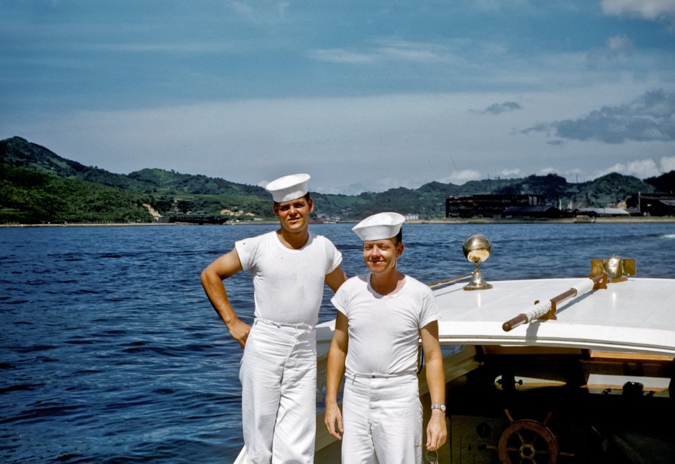 Free image of Two sailors smiling for the camera, posing on their boat, USA