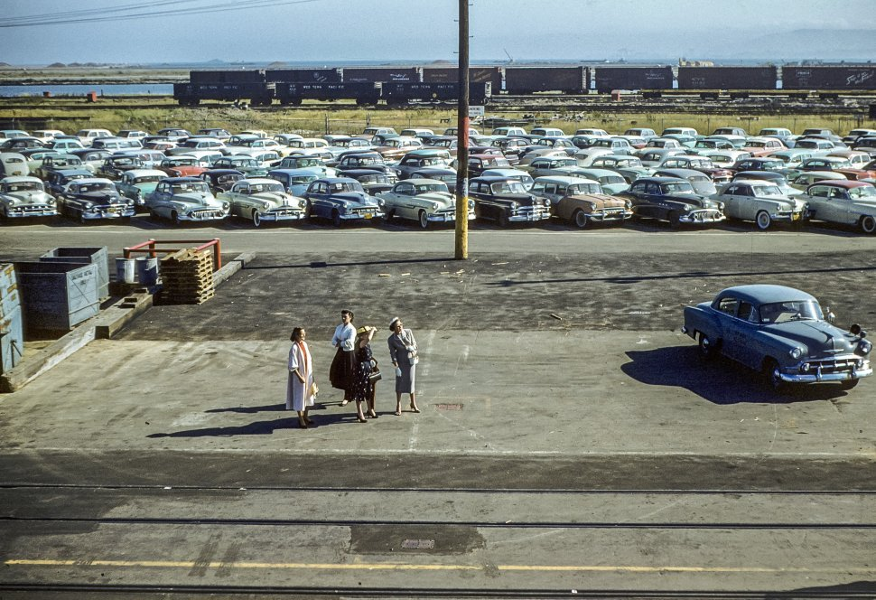 Free image of Aerial view of four women standing in the parking lot of a train station, USA.