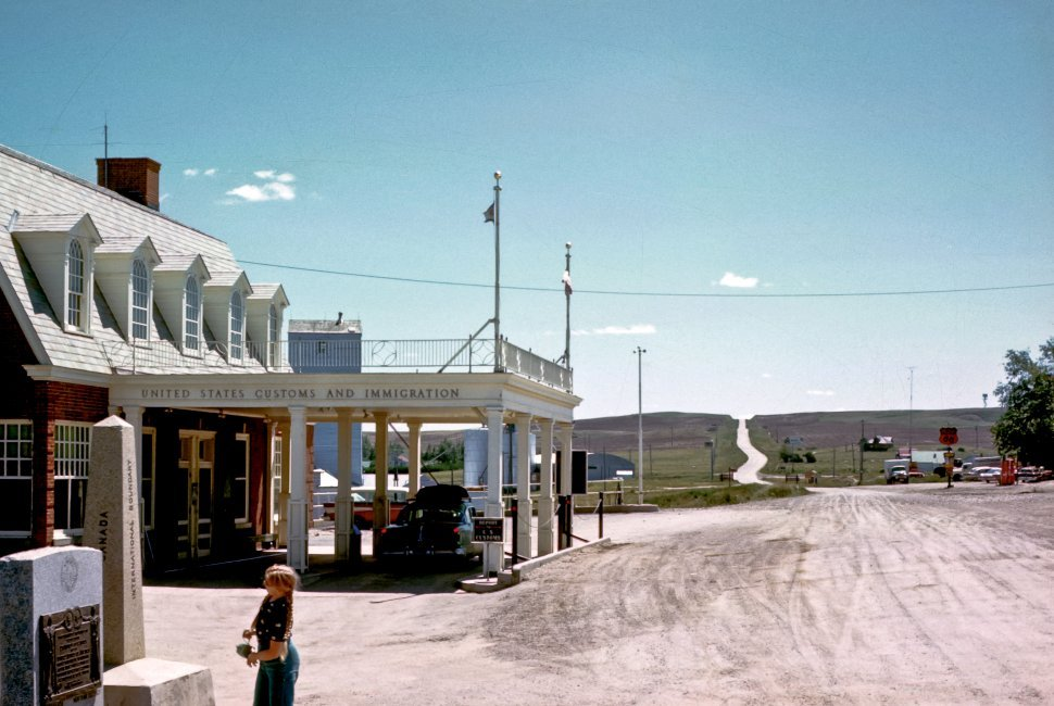 Free image of United States customs checkpoint with a woman standing outside, USA
