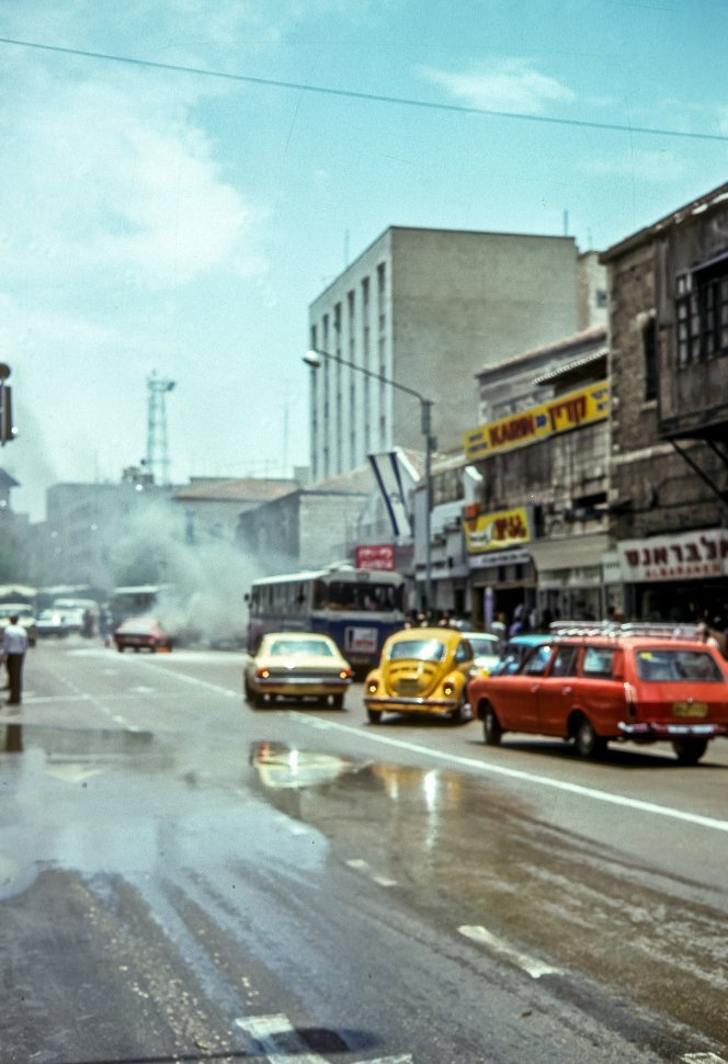 Free image of Traffic accident and smoke on the street.