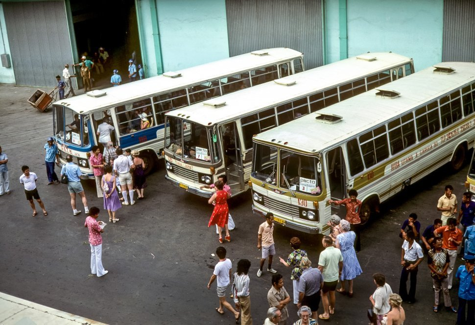 Free image of Aerial view of people at a bus stop.