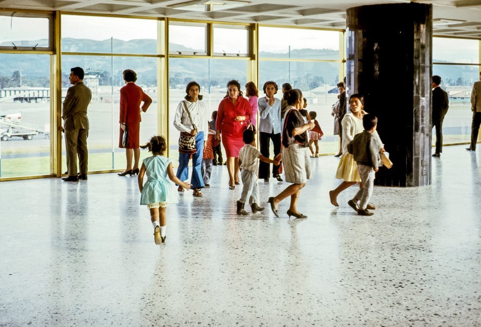 Free image of Family moving through an airport.