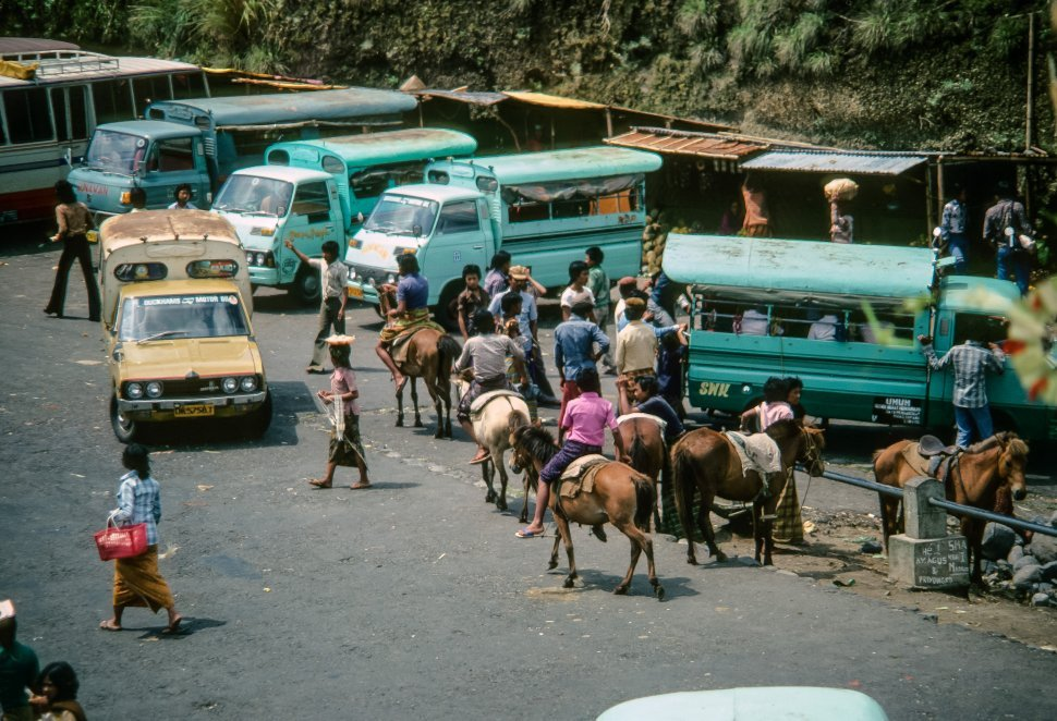 Free image of Aerial view of people on horseback in a maketplace, Asia