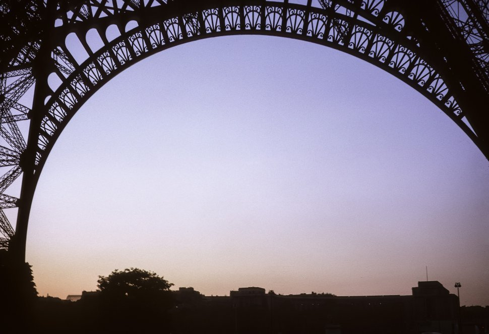 Free image of View of the iron work and underside of the Eiffel Tower with sunset behind, Paris, France