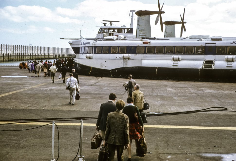 Free image of Tourists boarding a large ferry on the dock.