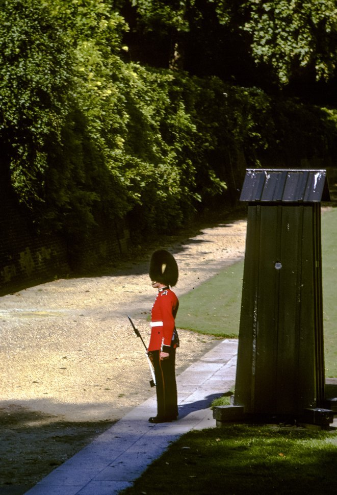Free image of Guard standing at attention below a guard tower, London, England