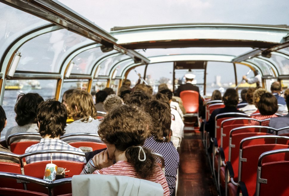 Free image of Tourists in the upper level of a double decker ferry boat ride.