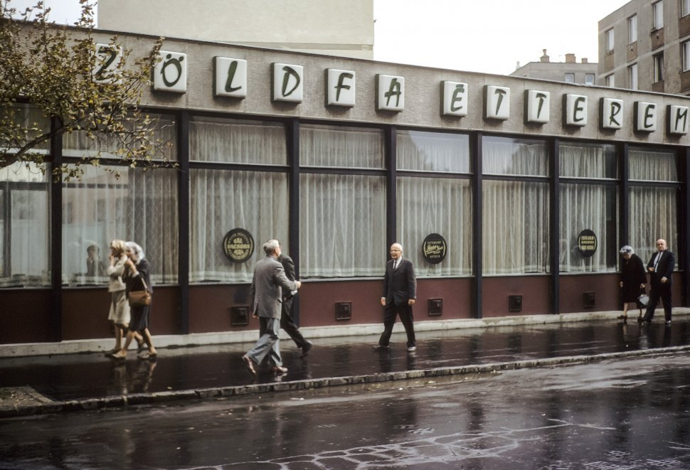 Free image of People walking past a restaurant, Hungary