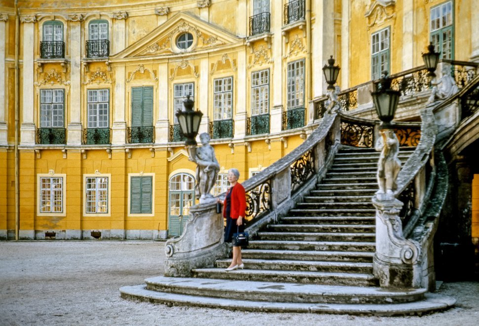 Free image of Woman posing in front of a palace facade.