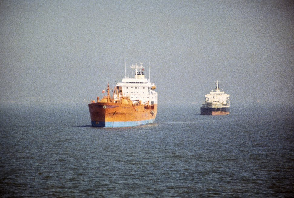 Free image of Two ships travelling through the water.