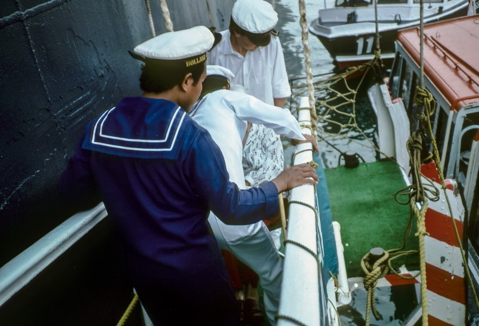 Free image of Sailors loading gear onto a ferry.