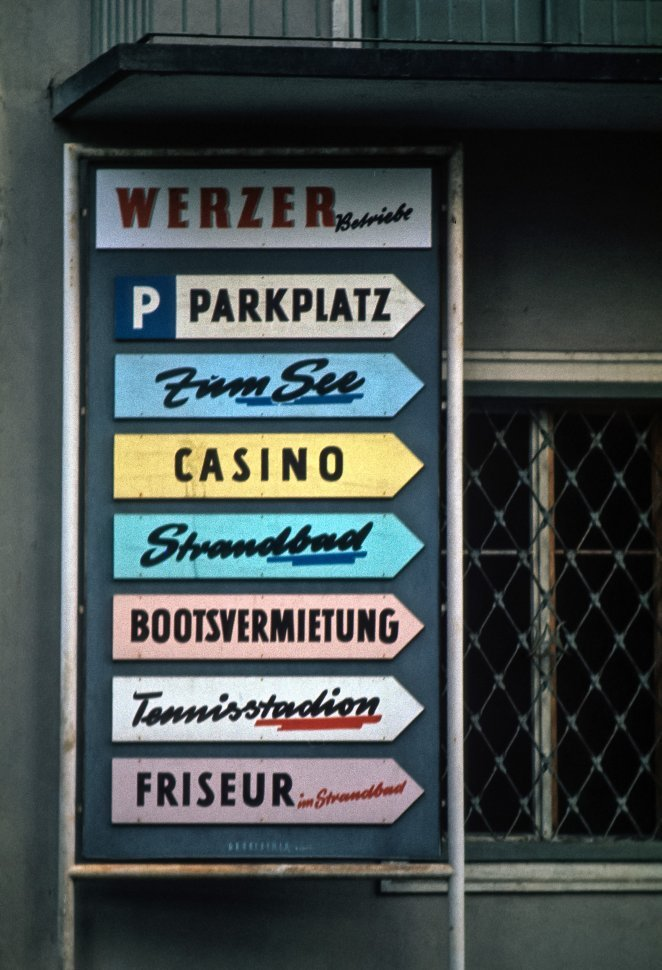 Free image of Group of colorful signs showing different attractions, Europe
