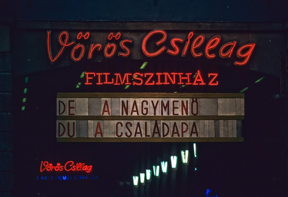 Free image of Red neon signs and movie marquee.