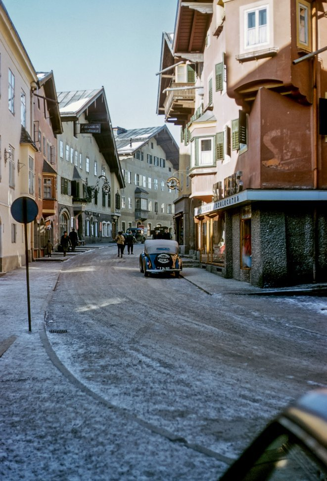 Free image of People walking down a small icy street, Europe