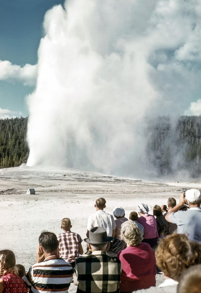 Free image of Group of tourists watching a geyser steam, Yellowstone National Park, Wyoming