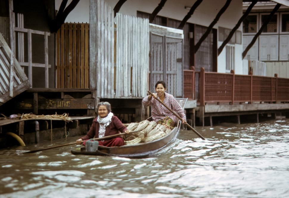Free image of Two women smiling while paddling their boat down a canal, circa 1974, Hong Kong, China