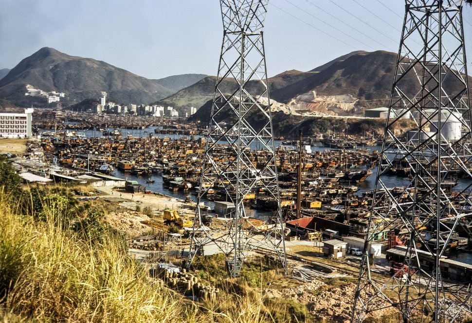 Free image of Aerial city view of harbor and power lines, circa 1974, Hong Kong, China