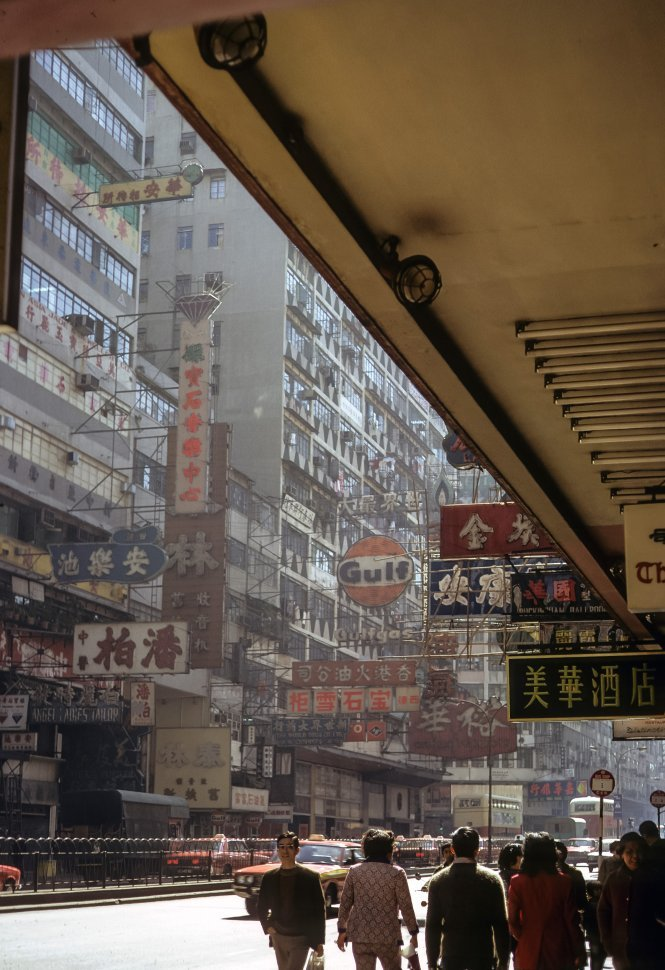 Free image of Signs lining a busy street, circa 1974, Hong Kong, China