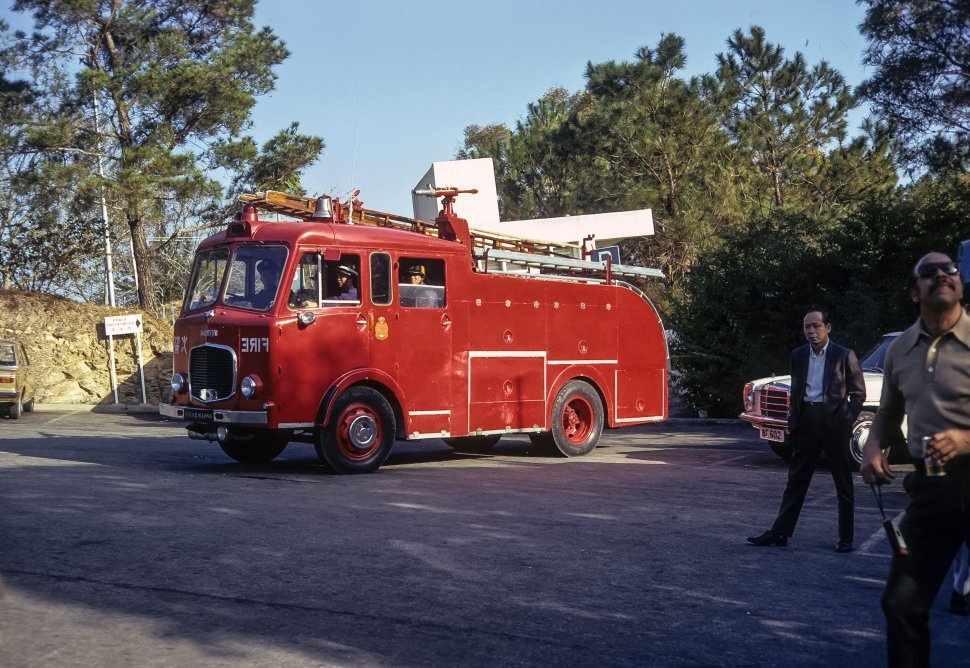 Free image of Men sitting in a vintage fire engine, circa 1974, Hong Kong, China