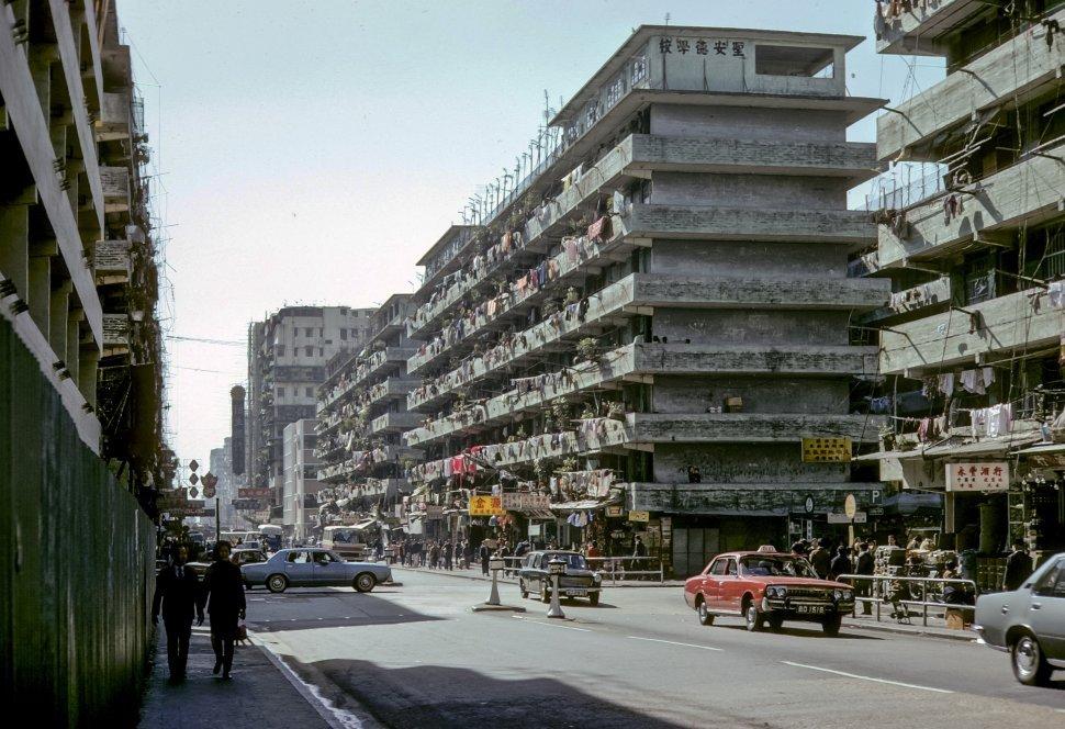Free image of Laundry hanging from balconies along a busy city street, circa 1974, Hong Kong, China