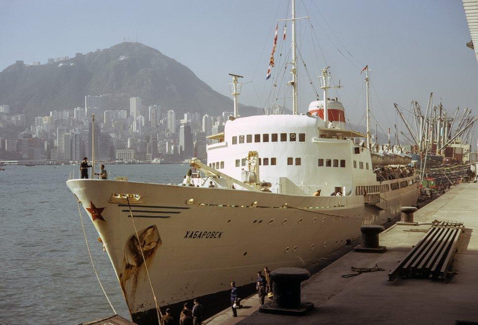 Free image of Cruise ship with sailors docked at port, circa 1974, Hong Kong, China