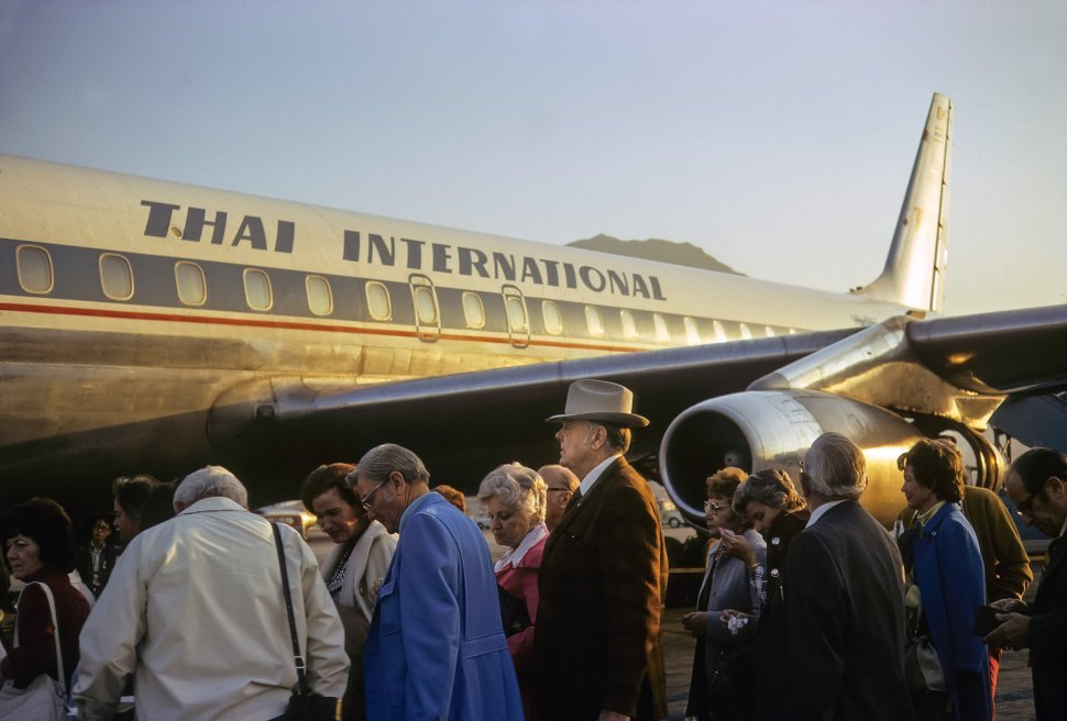 Free image of Tourists boarding an airplane from the runway, circa 1974, Hong Kong, China