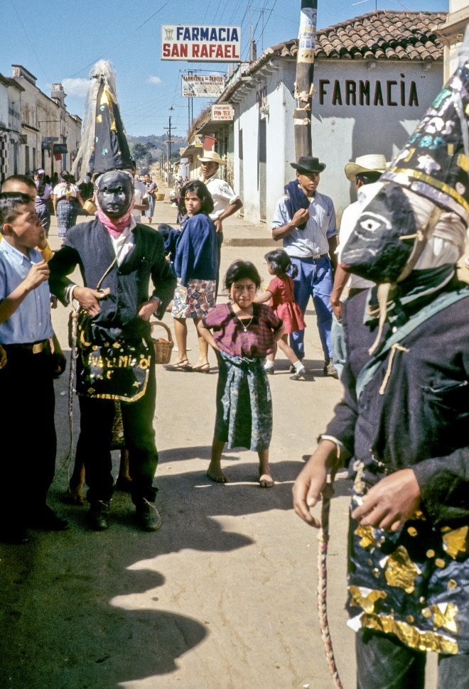 Free image of People celebrating festival in the street in costumes and masks, circa 1969, Antigua