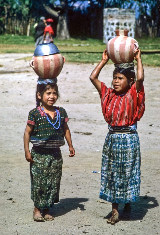 Free image of Girls carrying water vessels on their heads, circa 1969, Antigua