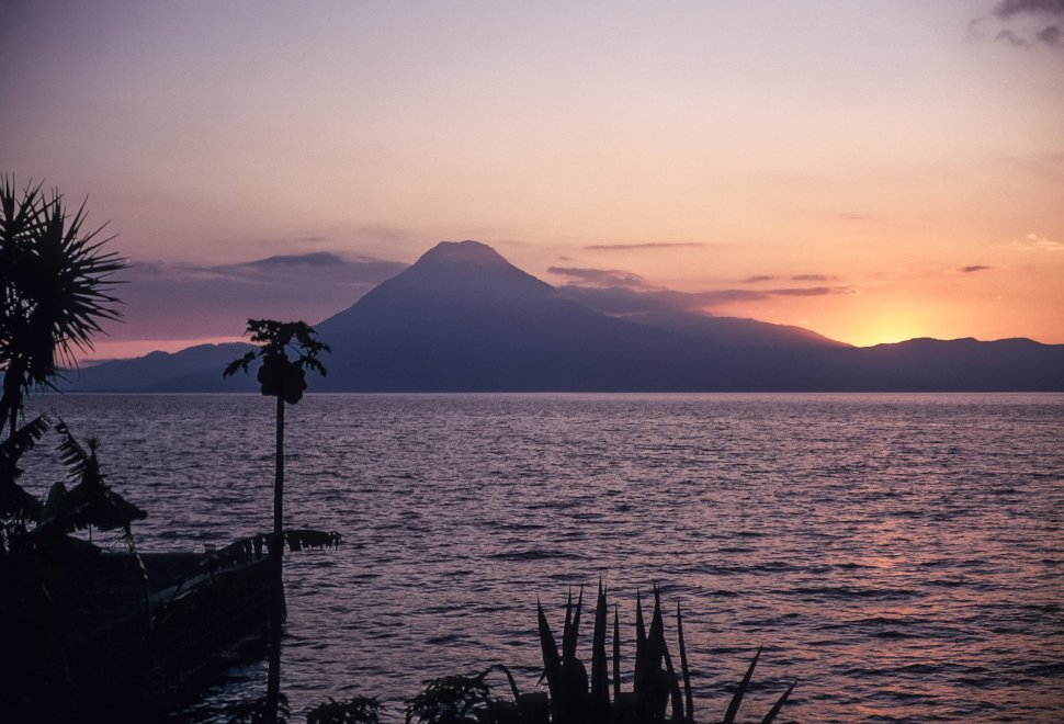 Free image of Colorful sunset behind tropical island and volcano, Chichicastenango, Guatemala