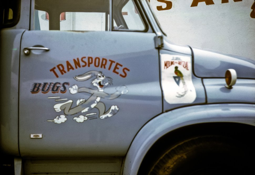 Free image of Cartoon rabbit in an ad on the door of a truck, Chichicastenango, Guatemala