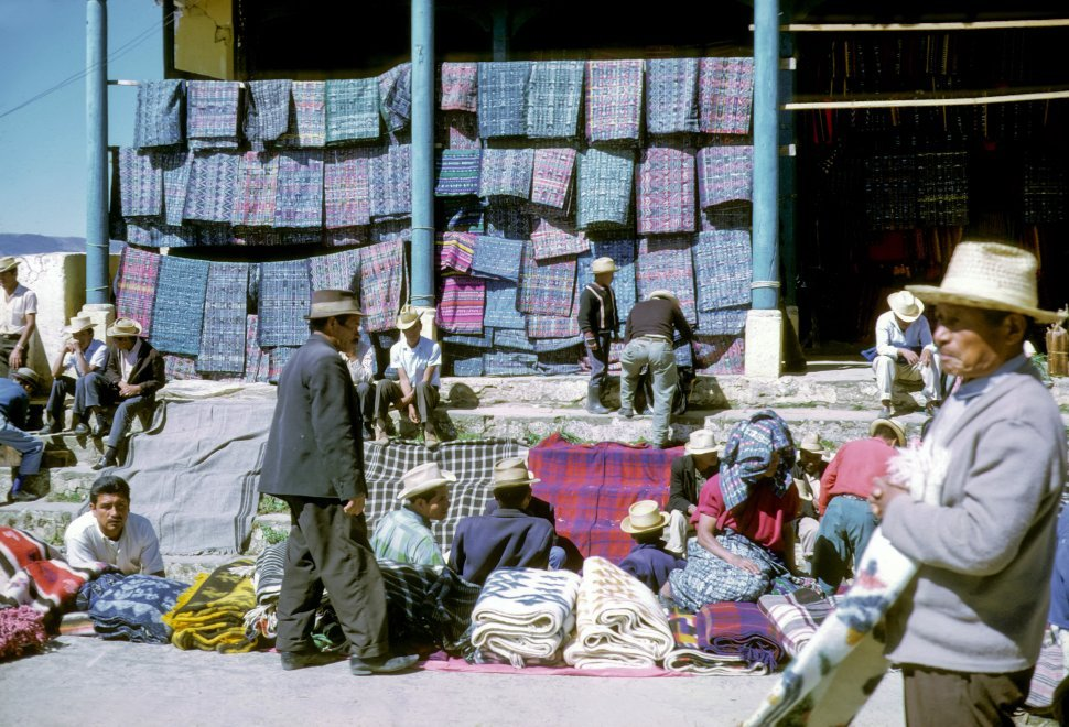 Free image of Men selling their goods at a marketplace, Chichicastenango, Guatemala