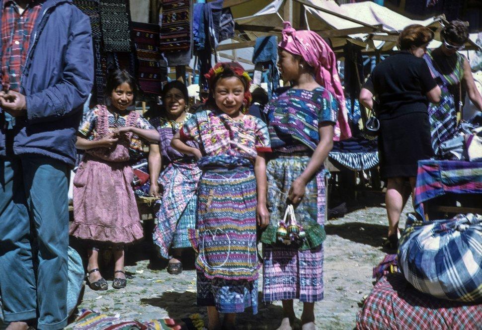Free image of Children smiling at the camera in marketplace, Chichicastenango, Guatemala
