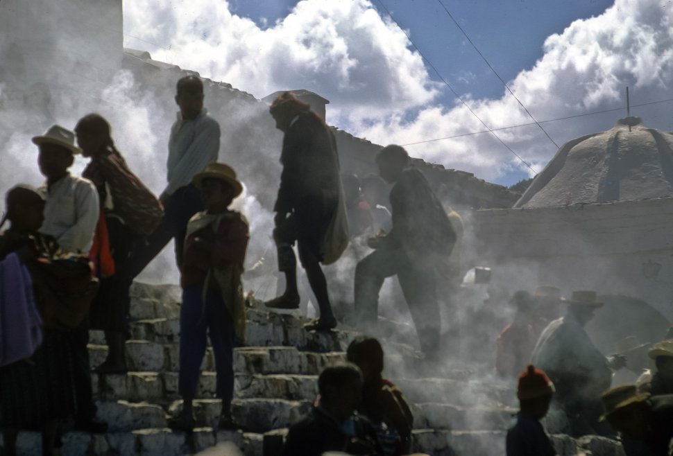 Free image of Locals walking through a smoky area up stone stairs, Chichicastenango, Guatemala
