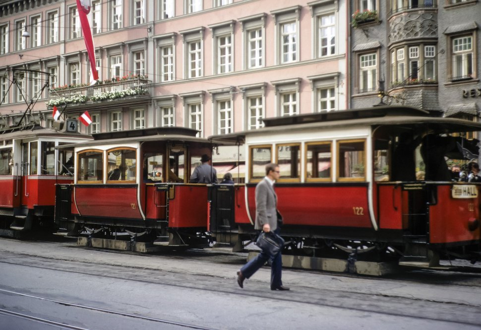 Free image of Man walking past trolley cars, circa 1968, East Berlin, Germany