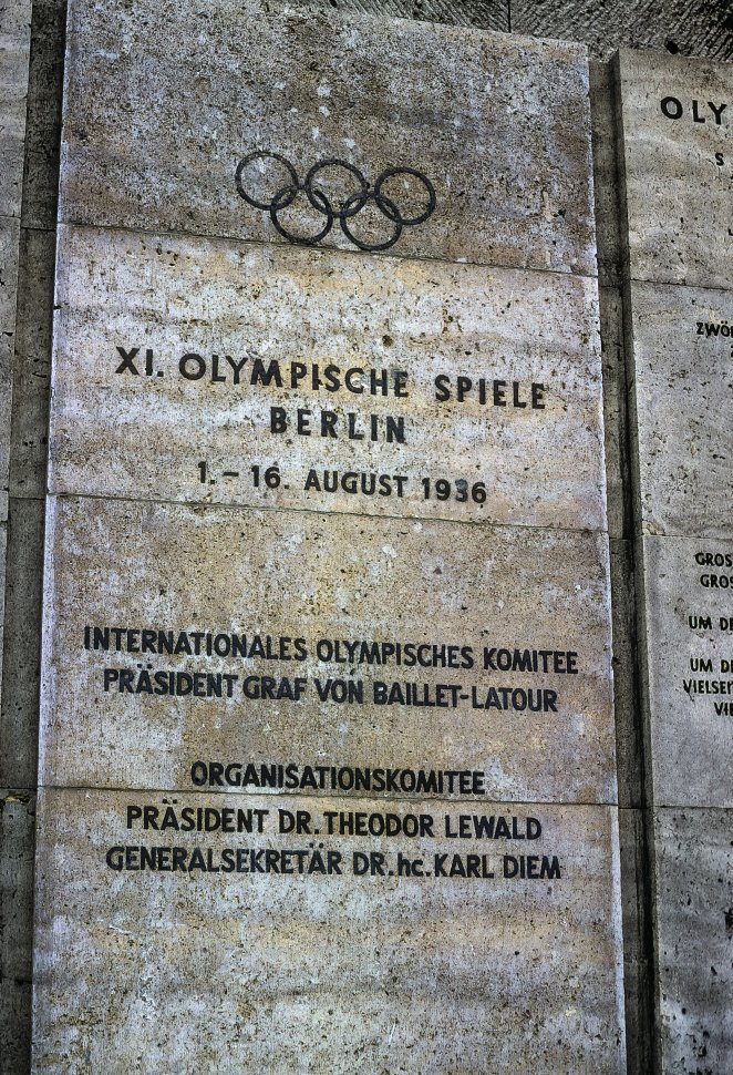 Free image of Stone wall tablet with information regarding the 1936 Berlin Olympics, circa 1968, East Berlin, Germany