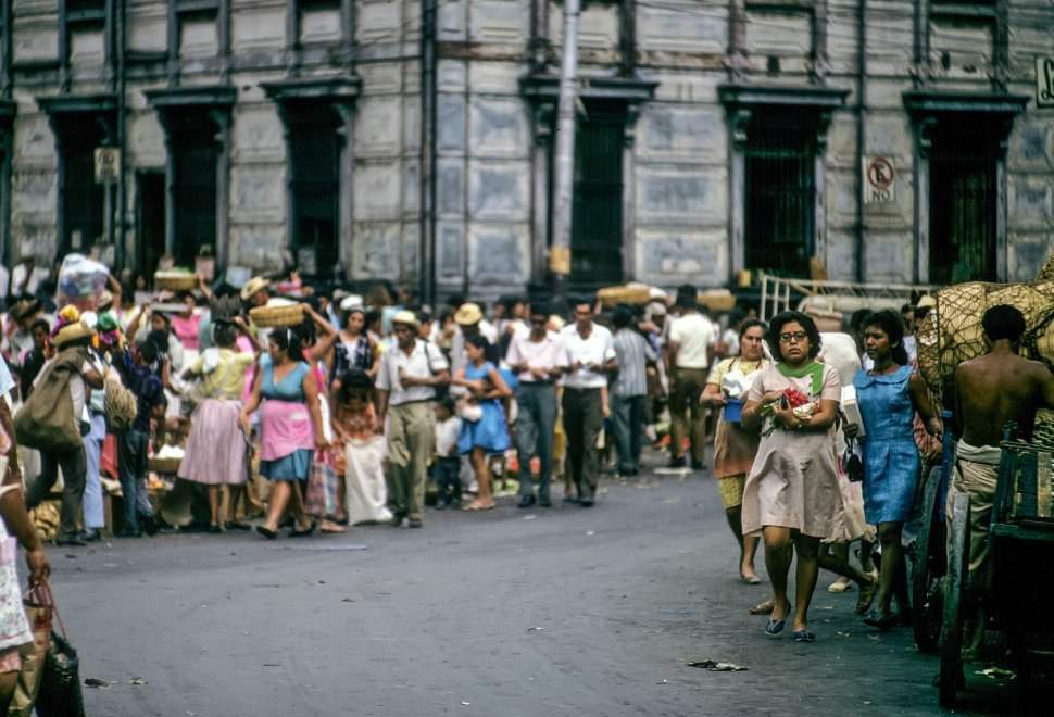 Free image of Women walking through the street with their goods from the crowded marketplace, San Salvador