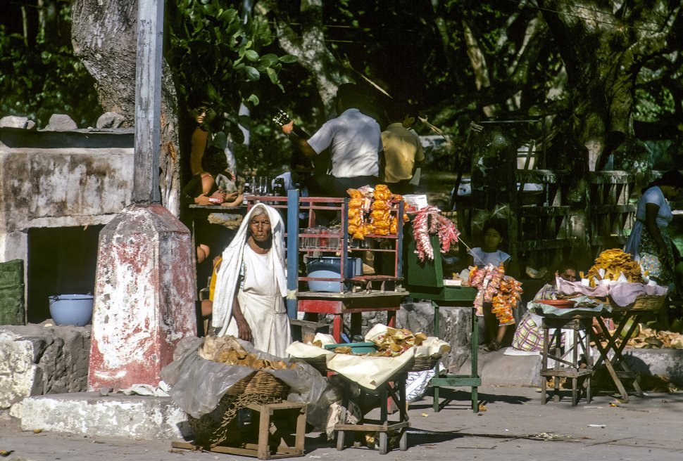 Free image of Old woman selling at a food stand, San Salvador