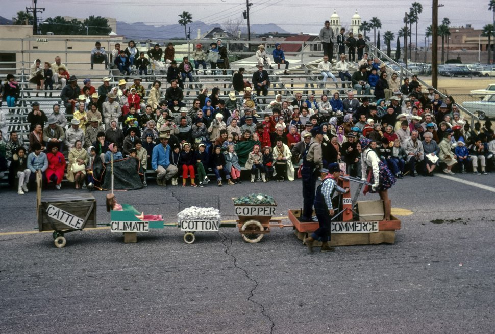 Free image of People in costume riding an agricultural themed float, Tucson, Arizona, USA