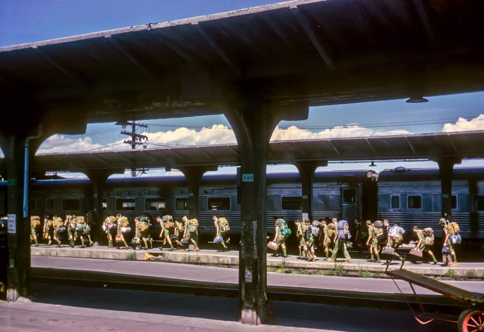 Free image of Large group of boy scouts disembarking a train with their equipment, USA