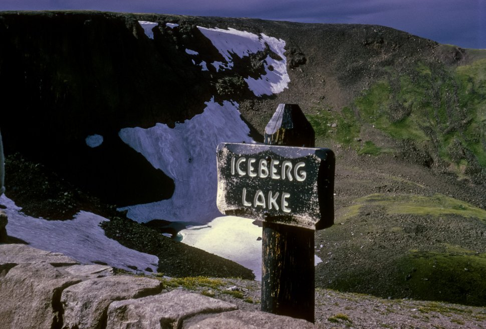 Free image of Sign for Iceberg Lake and valley below, Alaska
