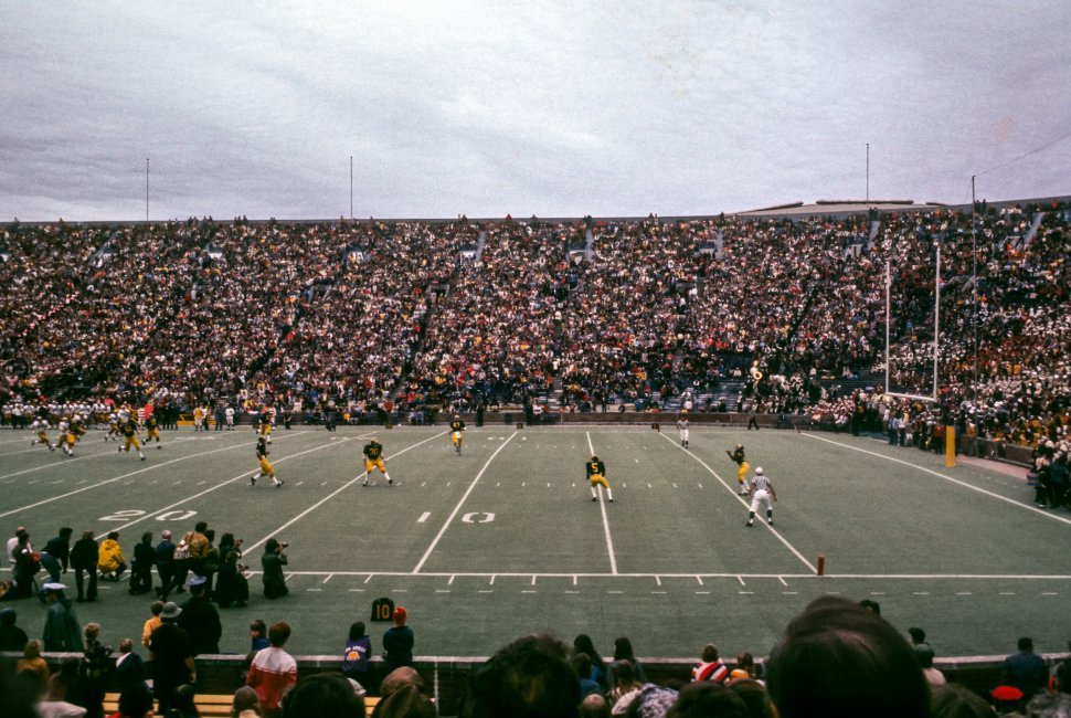 Free image of Football players on the field on a cloudy day, USA