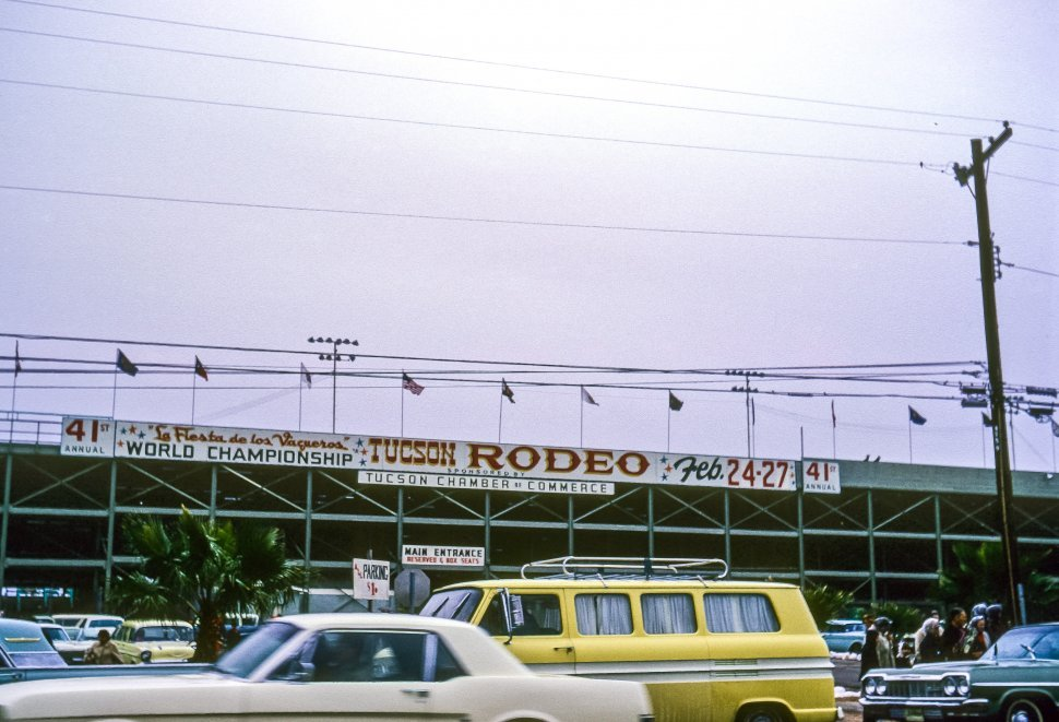 Free image of Cars driving past the Tucson Rodeo signs, Tucson, Arizona, USA