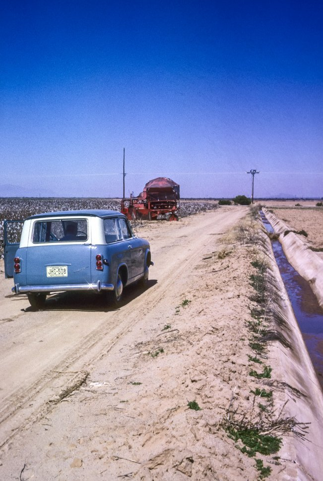 Free image of Vintage car parked at an irrigation ditch and field, USA