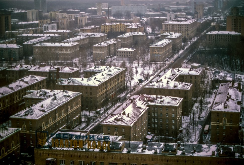Free image of Aerial view of snowy streets and rooftops, Russia