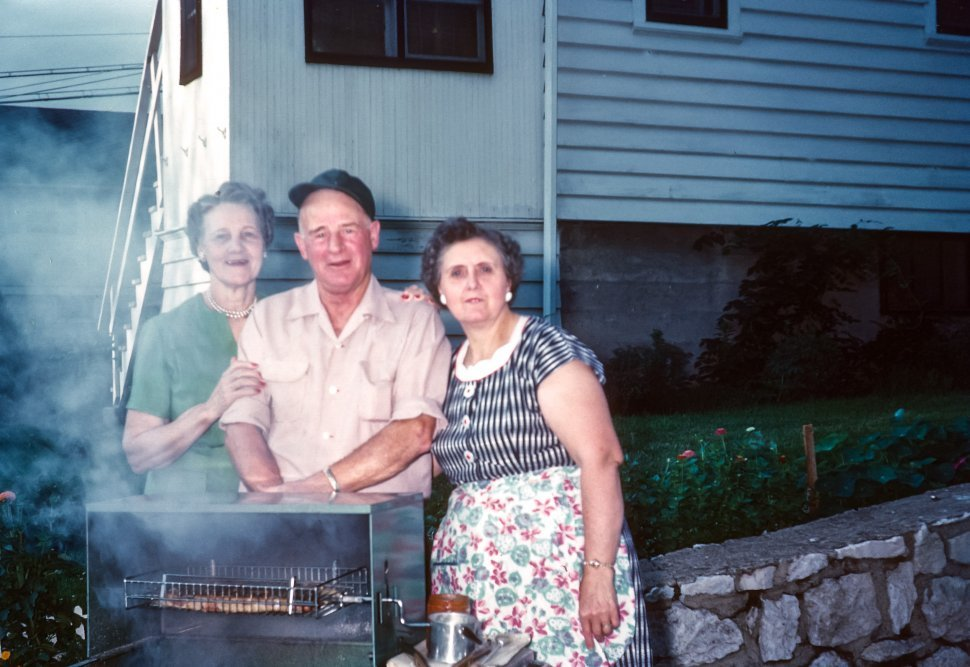 Free image of Farming family barbecuing and posing for a photograph, USA