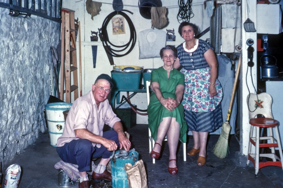 Free image of Farming family in a work shed posing for a photograph, USA