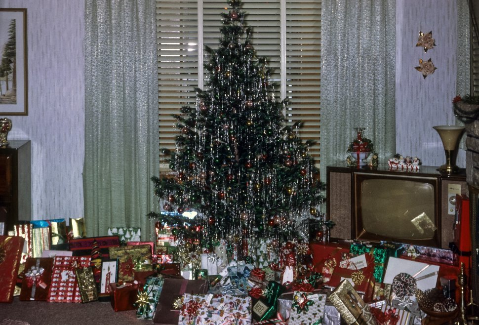 Free image of Christmas tree and gifts in an American suburban home, USA