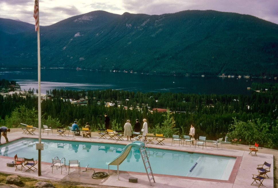 Free image of Group of tourists at the pool, looking out at the lake view, USA